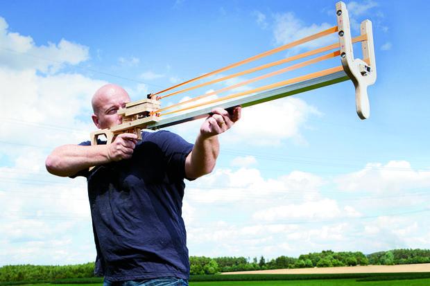 20-metre-long DIY catapult-crossbow blasts a full-size machete ...