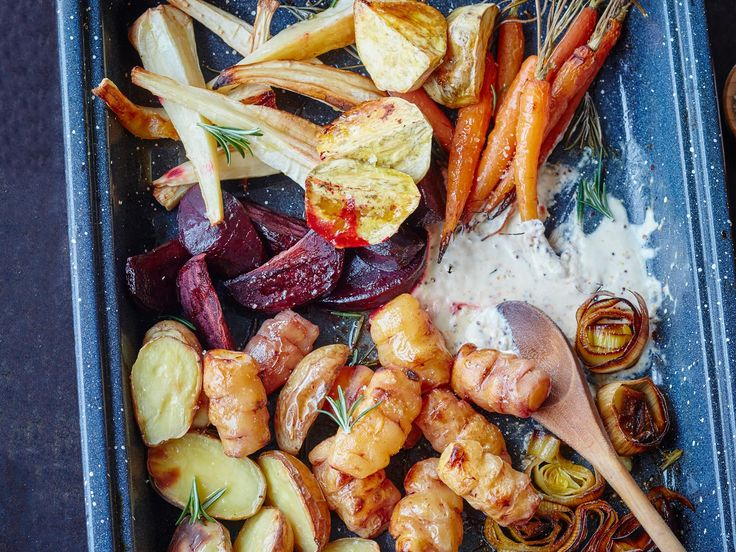 The trick to roasting vegetables to perfection is to cut them to roughly the same size and add each to the roasting pan according to how long they take to cook. This tray, complete with gravy, is a meal in itself!