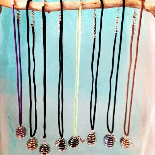 """Crystal Cage Necklaces with charms $15 each  To place an order, visit our Facebook page """"Moonsong Jewellery"""" or email moonsongjewellery@gmail.com"""