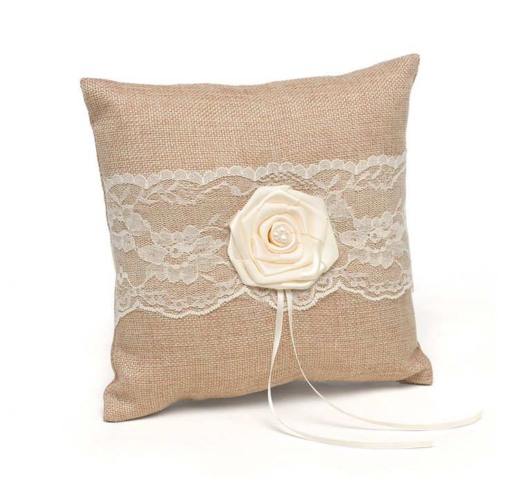 The Rustic Country Ring Pillow is covered in natural burlap and features beautiful ivory lace, a large satin rosette, pearl accents and ivory satin ribbons to tie your wedding rings on. It will give that little extra touch of vintage detail to your wedding ceremony