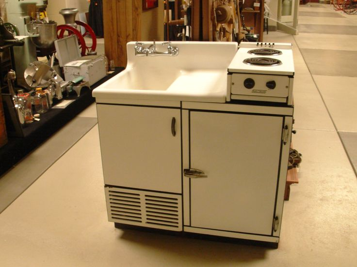 Lovely It Has A Sink, Icebox, And Electric Stove Top Combined Into One Tiny Unit.
