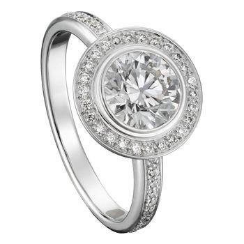クローズド セッティングのダイヤモンドがそれを取り巻く小さなパヴェにより、更なる輝きを増す。 *エンゲージリング 婚約指輪・カルティエ一覧*