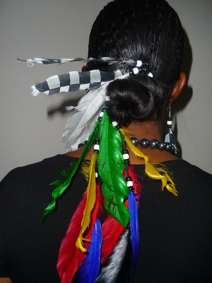 Nascar-inspired feather ponytail holder. Nascar-inspired feather ponytail holder. Feather colors are of all the flags (yellow, green, blue, white, red, black, checkered) with black & white beads.