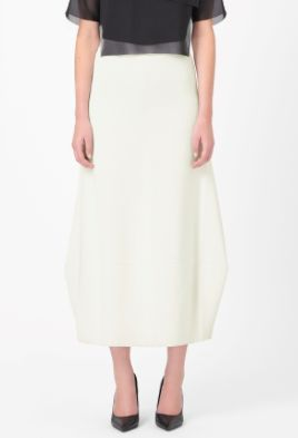 Made from panels of fine milano-knit with a soft wool interior, this skirt is an elongated style with modern folded pleats on each side. Fitted at the top and flaring towards the hemline, it is secured with a hidden zip fastening on the back