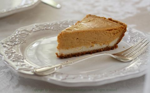Vegan Double-Layer Pumpkin Cheesecake. Going to make this for thanksgiving but do it in bar form and swirl the two flavours together