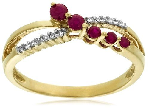 Rubies and diamonds cross paths in this beautiful split band journey ring, made from polished 10 karat yellow gold. It features a line of five round rubies, graduated in size and held in shared prong settings. The rubies trace a diagonal across the top of the finger, weaving across a line of 13 shimmering diamonds accents (.05 cttw). This graceful, feminine ring is very flattering on the finger and makes a lovely gift for a special occasion.