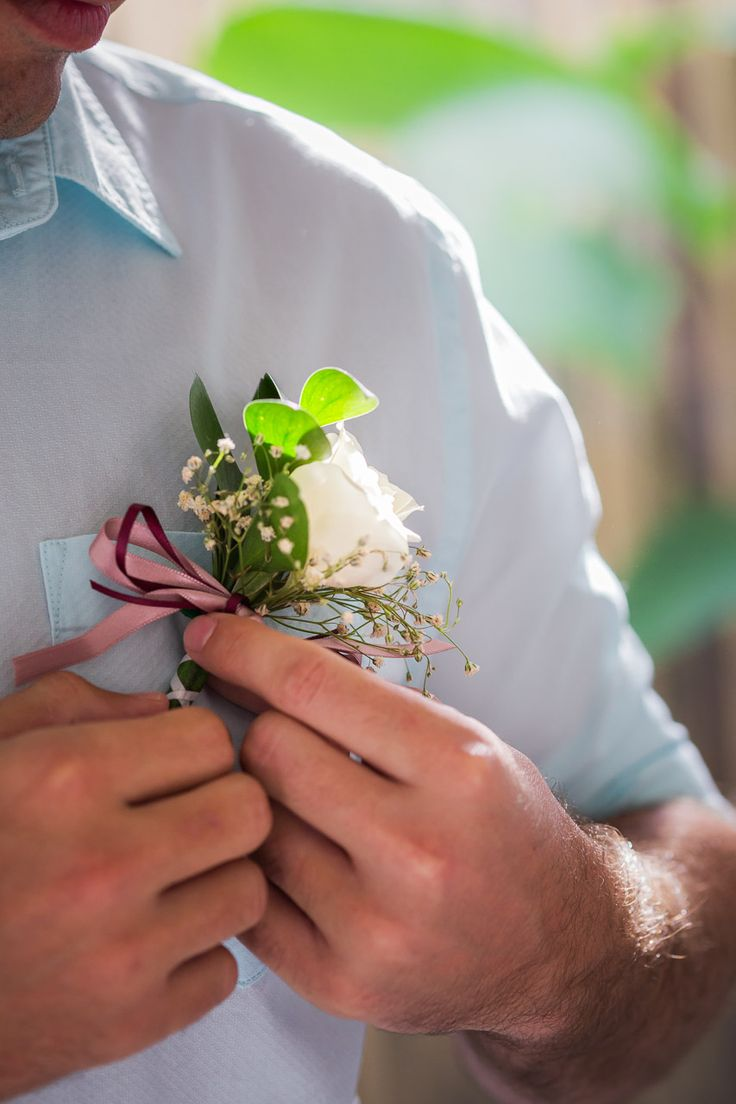 When the groom has his flowers right