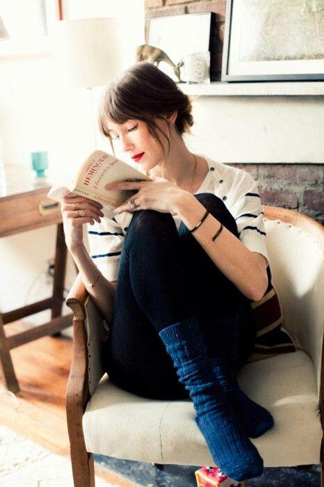 Brunette reading in socks