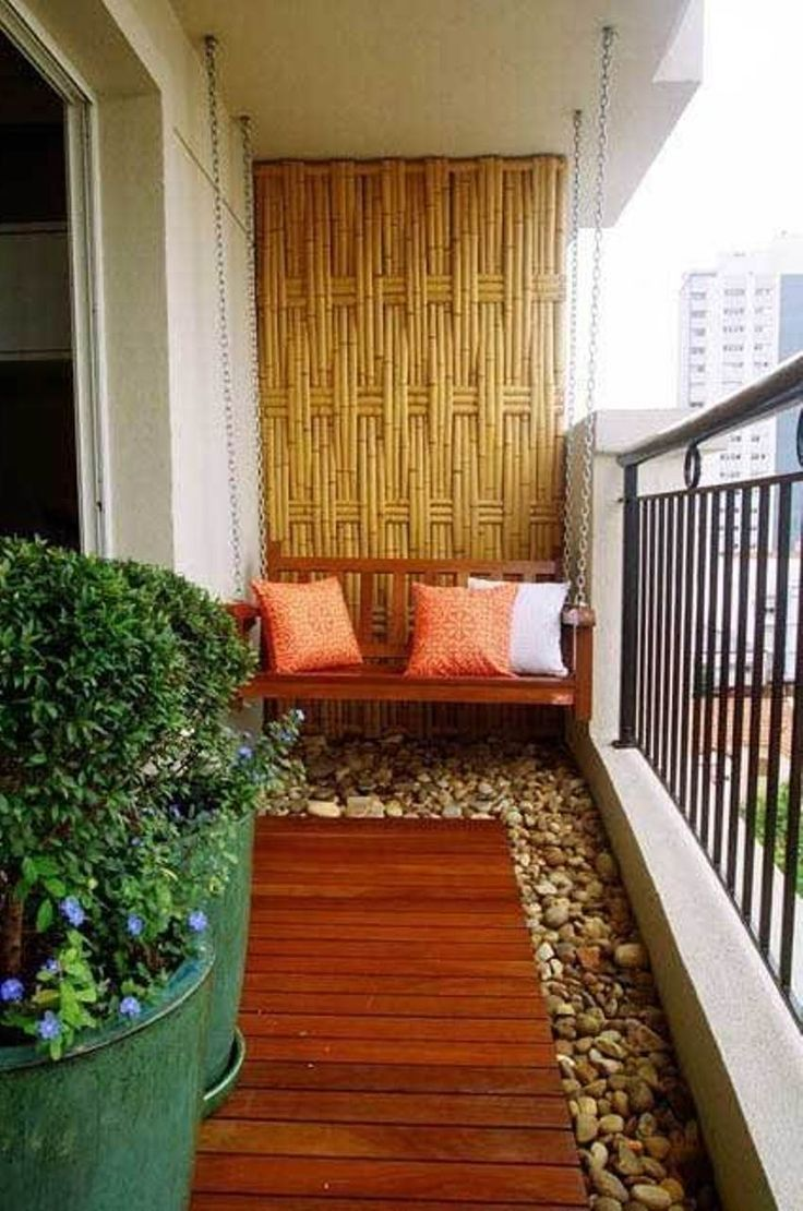 Wood on floor n on the wall then some stones make this balcony more natural