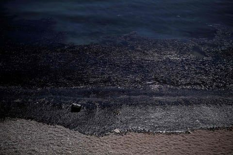 Salamis, Greece  Oil washes ashore a beach after an old tanker sank near the island of Salamis. The coastguard said that an entire bay on the southeast of the island had been affected after the Agia Zoni II, carrying 2,500 metric tonnes of fuel, sank last weekend. Photograph: Angelos Tzortzinis/AFP/Getty Images