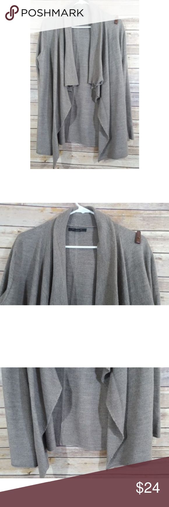TAHARI Draped Open Front Cardigan Sweater Great used condition  Up for sale is a light brown draped open front cardigan sweater. 50% Merino Wool 50% Acrylic  Measurements  Across the chest-22  Length-28  Sleeves-24 Tahari Sweaters Cardigans