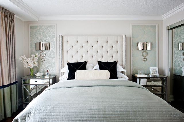 elegant contemporary master bedroom with modern wall sconces master