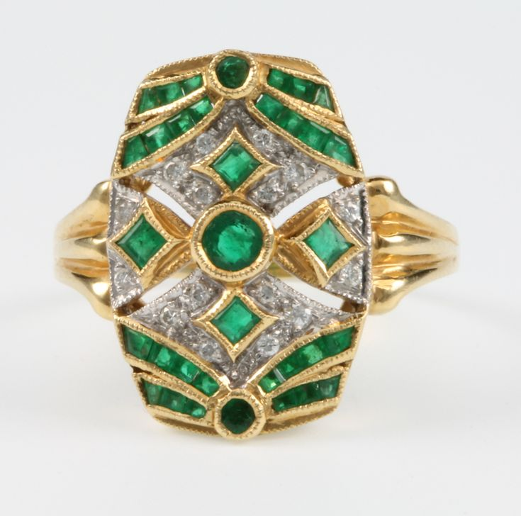 Lot 644, An 18ct yellow gold emerald and diamond up finger Art Deco style ring, size R 1/2, sold for £400