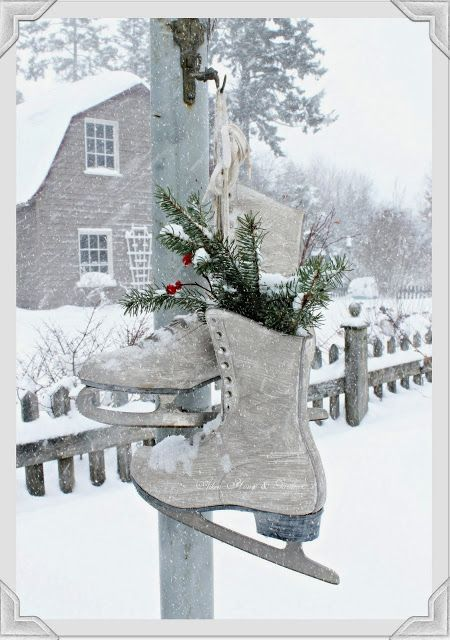 Vintage skates hanging on the lamp post on a snowy winter day. Aiken House & Gardens