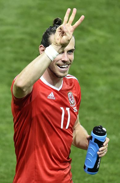 #EURO2016 TOPSHOT Wales' forward Gareth Bale indicates the team's 30 win in the Euro 2016 group B football match between Russia and Wales at the Stadium...