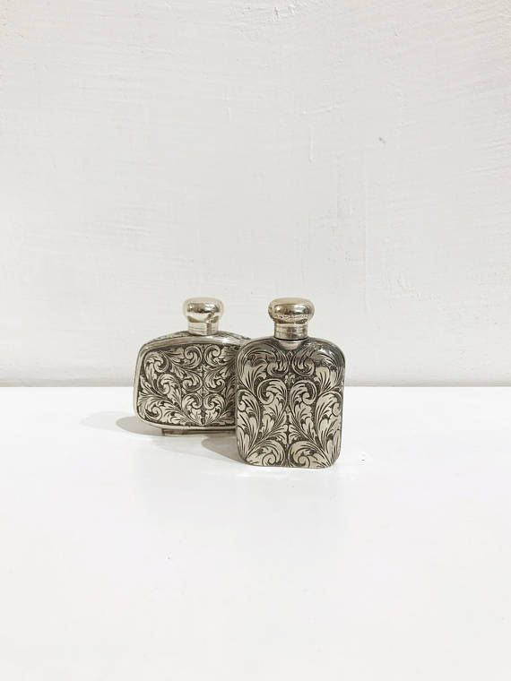Italian perfume bottle covered in a brocade style decor