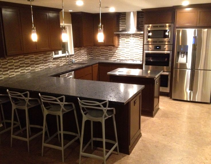 Ralph Lauren Allen Mini Pendant; Kartell Masters Stool; Bosch Double Oven, Microwave, Range, Hood, Dishwasher; Samsung Refrigerator; Cork flooring