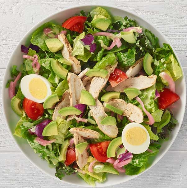 <b>Customized by Mitzi Dulan.</b> Chicken raised without antibiotics, arugula, romaine, kale and radicchio blend, vine-ripened tomatoes and pickled red onions tossed with freshly made Green Goddess dressing and topped with avocado and cage-free hard-boiled egg. Available in whole and half. (Nutritional values below are based on whole serving. For detailed nutrition facts on all items based on serving size, please download our <a href=