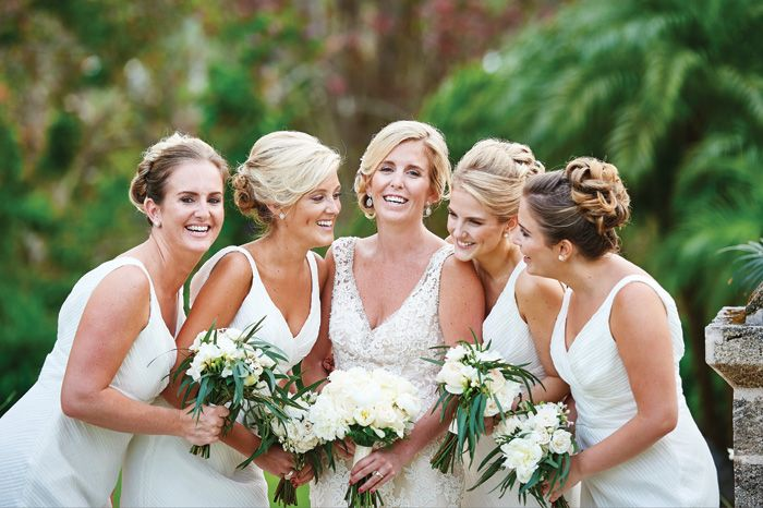 Nina put her bridesmaids in all-white and we think they are stunning! Click through to see more. #wedding #bermuda #bermudianwedding #bermudawedding #whiteandivory