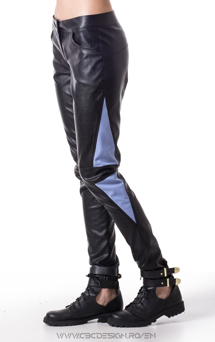 Description: Long eco-leather pants with pockets and side insertions. The arctic-blue softshell triangles inserted on the sides and a horizontal knee elements, combined with the eco-leather fabric, makes them a chic pair of biker pants. The pop of color brings a playful vibe. For a casual look, wear with a warm pullover and boots. The glam look requires an airy top and platforms.