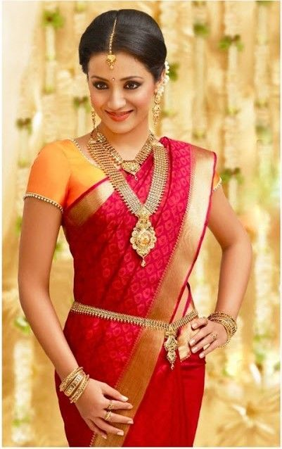Here's a great look for a #SouthIndian Bride - red silk #Saree with an orange blouse and gold Jewelry & saree belt