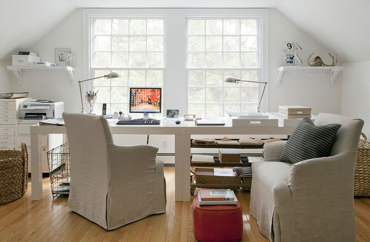 Comfy chairs, desk with no drawers, just clean lines, organized yet comfortable and with a lovely view.