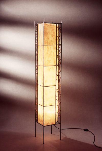 """Between two tracks"" H. 168 – B./W. 27 – D. 27 ~~ Wrought iron, composite material, brass ~~ Gesmeed ijzer, composietmateriaal, messing ~~ Standard lamp, lightobject, lighting, handmade, interior, design ~~ staanlamp, vloerlamp, lichtobject, verlichting, handgemaakt, interieur"