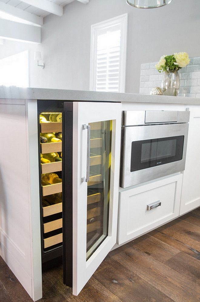 """Kitchen Peninsula. Kitchen peninsula dimensions. The base cabinet width is actually 84"""" ( 18"""" wine ref, 24"""" mic drawer, and 42"""" pull out corner cabinet. The counter depth is 52 """" and counter width is 96"""" due to a 12"""" overhang on both sides. Dannielle Albrecht Designs"""