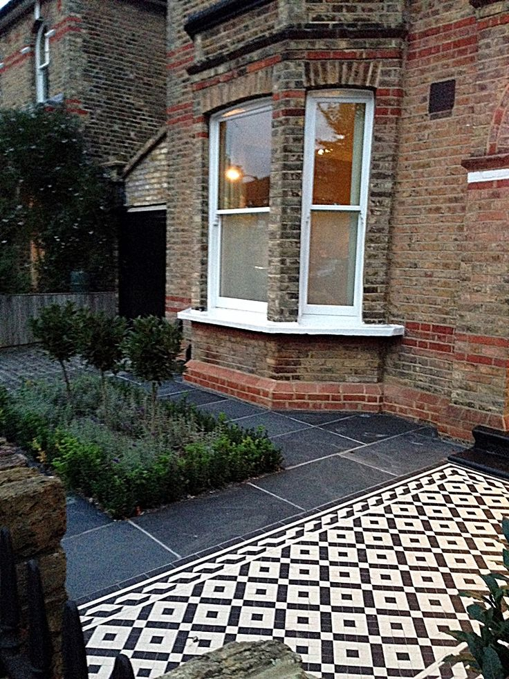 Cute black and white victorian mosaic tile garden path slate paving yellow stock brick wall dulwich peckham herne hill london