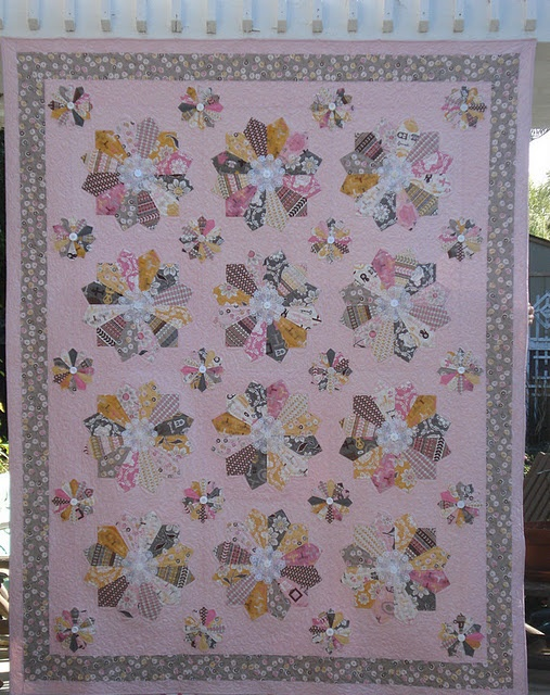 Gee, I just love these colors in this the Daisy Cottage line!  The gray is pulling on my heart strings and the pink are are so fun!  The dresdens do show off the fabric better with 12 blades as apposed to 20.  I love the doily and button centers, too!!