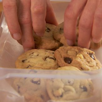 Always pack cookies in layers between wax or parchment paper in an