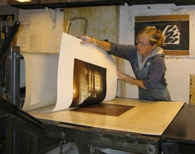 Anja Percival using printing press