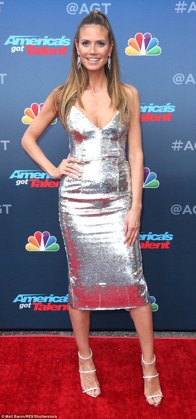 Heidi Klum showcases her fabulous figure in plunging silver gown | Daily Mail Online