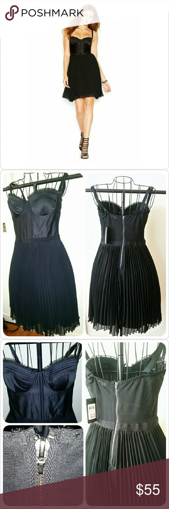 "*Guess* Corset Dress Black corset dress w/ pleated skirt and removable adjustable shoulder straps. Zipper in back. Skirt is lined. (Pic 3 shows where zipper handle is missing, but it's still is easy to grasp and zip.) About 30"" in length, exclusive of straps. 100% Polyester Guess Dresses"