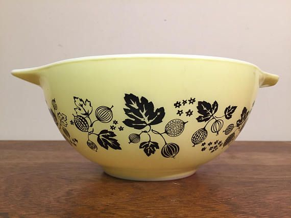 """1950s vintage Pyrex black and yellow """"Gooseberry"""" Cinderella bowl 442 from HobAndNail on Etsy."""