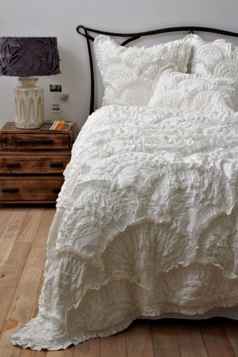 Wowwwww...love. Anthropologie no longer sells this bedding so I've linked this to a tutorial of diy Rivulets Bedding. She did a wonderful job!