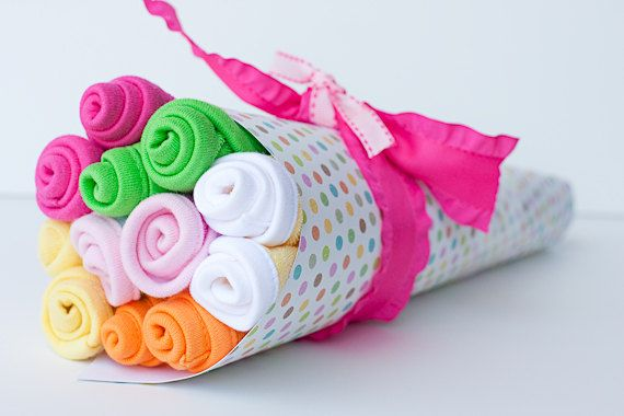 This adorable baby washcloth bouquet shows ONE DOZEN precious flowers. A washcloth bouquet makes a great baby shower gift and look sweet with