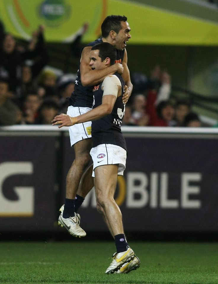 Eddie Betts and Jeff Garlett celebrate after a goal during the Round 19, 2010 match against the Essendon Bombers at the MCG. (Photo: Andrew White/AFL Media)