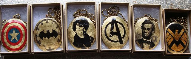 Geek Lockets by Ursula and Olive, via Flickr I want the Batman one n the abe Lincoln one