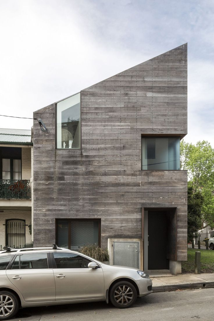A weathered slatted wood #facade gives this #home another dimension of texture & variation.
