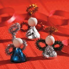Hershey's® Kisses® Angels Craft - instead of the wooden bead tho, I'd use another round candy ball of some sort. But then again, you could draw a little face on the wood.  hmmm...  Consider using a gumball, perhaps.  You could even use an edible ink pen to draw on a face.
