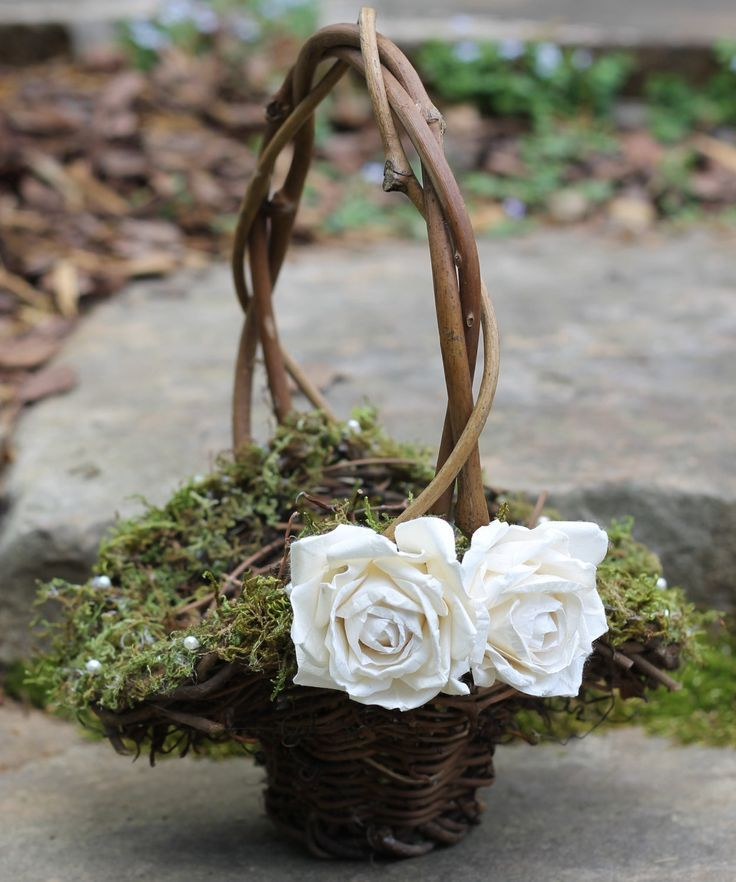 Wooden basket with moss for the flowergirl at a woodland wedding