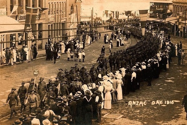 Historical Brisbane Anzac Day photos 1916: A crowd lines the streets to watch the procession of the 41st Battalion through Brisbane on Anzac Day. Photo: State Library of Queensland archives
