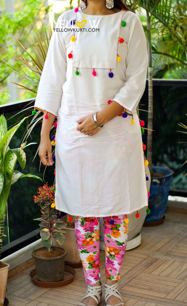 Rayon Kurti with multi colored pom poms all through the edges . Sizes - S  M   L  XL  XXL Price - 899 INR http://www.yellowkurti.com/Casual-wear-/Happy-Holi-id-2825038.html  07 March 2017