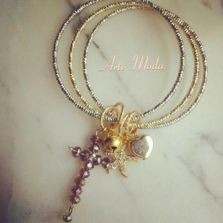 Modello Cerchi in silver&golden. ..con crocetta realizzata a mano anche in altri colori. .