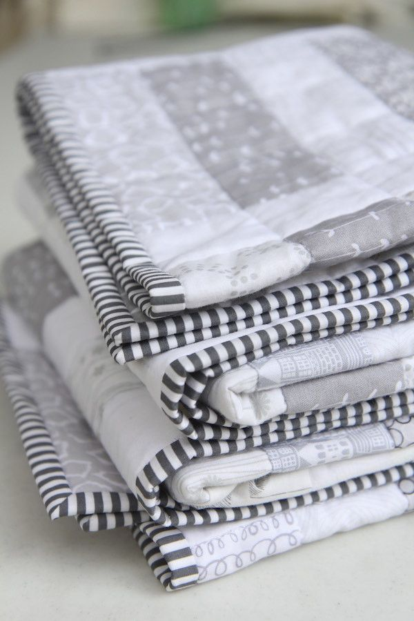 Beautiful low volume fabric quilt in grays and whites.