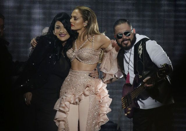 Jennifer Lopez hugs Suzette Quintanilla and A.B. Quintanilla, siblings of slain slinger Selena, during the Latin Billboard Awards Thursday, April 30, 2015, in Coral Gables, Fla. Lopez performed with Selena's band, which included the two siblings. (Photo by Lynne Sladky/AP Photo)