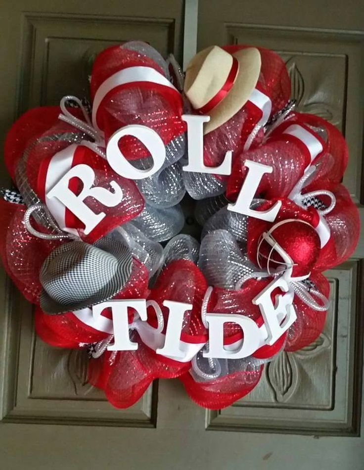 "This is a 24"" hand crafted University of Alabama deco mesh ""Roll Tide"" wreath. This wreath is accented with a houndstooth hat, a Bama football helmet and a Saban hat. ALL custom wreaths and hand paint"