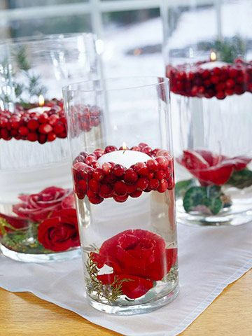 Seeing Red  Place red roses or amaryllises into a metal flower frog. Adhere the frog to the bottom of a glass cylinder with double-sided florist's tape. Pour water into the cylinder and float cranberries and a floating candle on top. Create a larger centerpiece by grouping cylinders in varying heights together.  Editor's Tip: Change the water daily. The arrangement should last up to seven days.