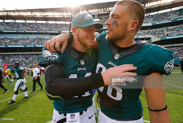 Carson Wentz #11 of the Philadelphia Eagles gets a hug by Zach Ertz #86 after…